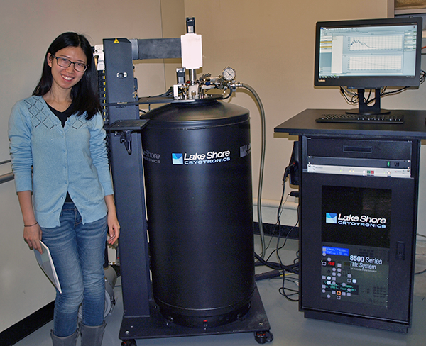 Yue Huang of the Mittleman Lab next to the 8500 Series THz system